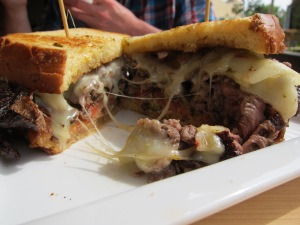 rib eye steak sandwich on jalapeno cheddar bread